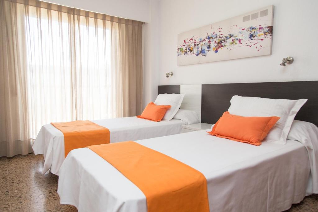 Rúm í herbergi á Pio XII Apartments Valencia