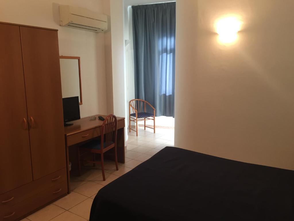 Letto o letti in una camera di Hotel Belvedere