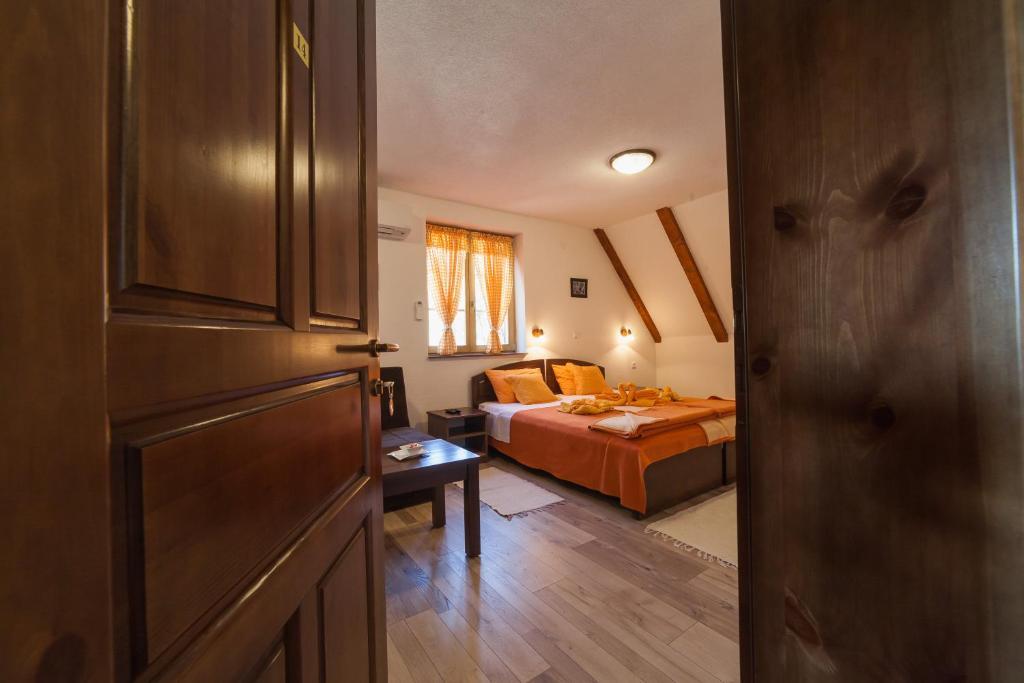 เตียงในห้องที่ Guest House Rustico