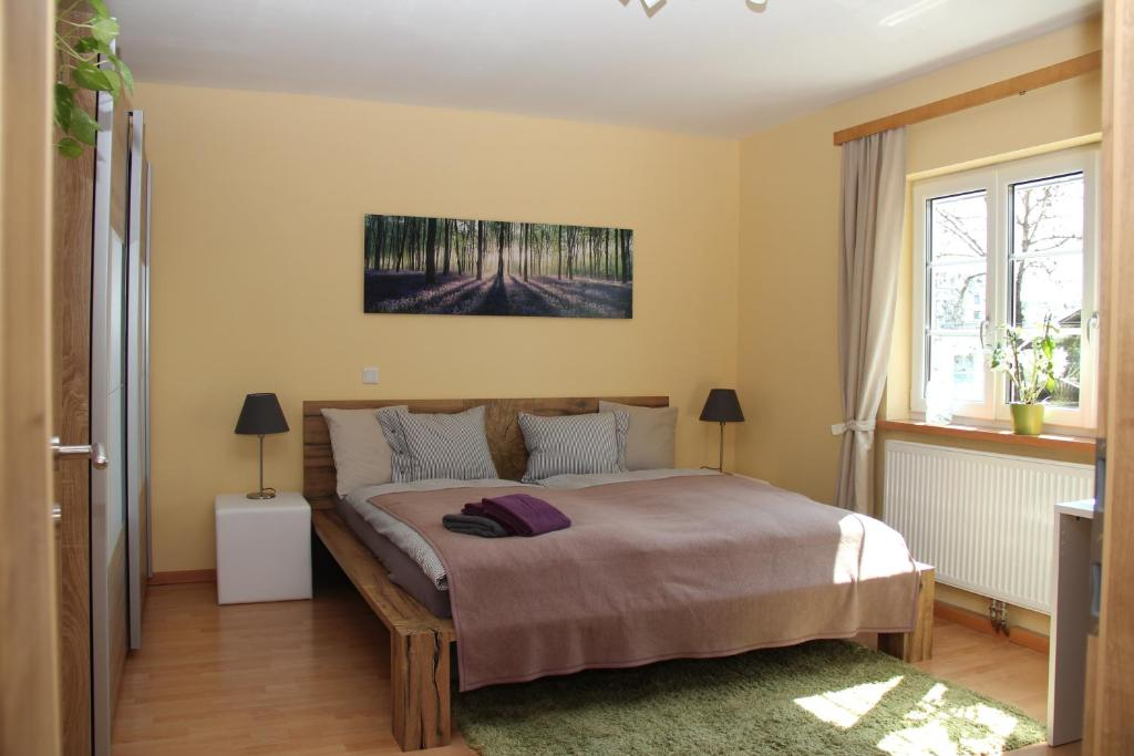 A bed or beds in a room at Apartment Kleßheim