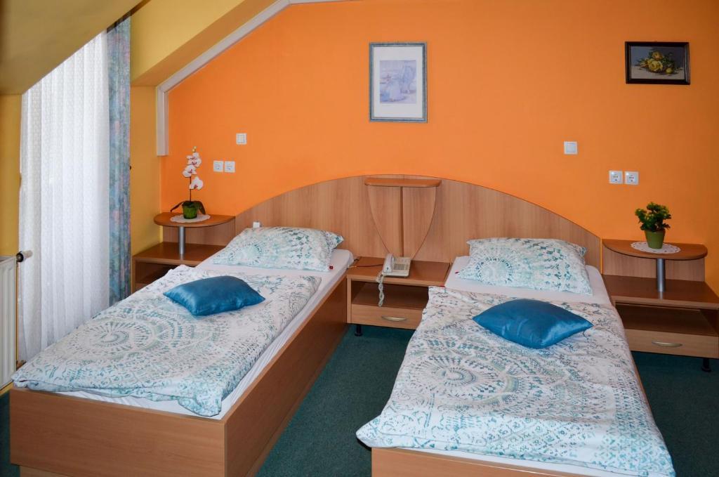 Postelja oz. postelje v sobi nastanitve Penzion Gostilna Keber