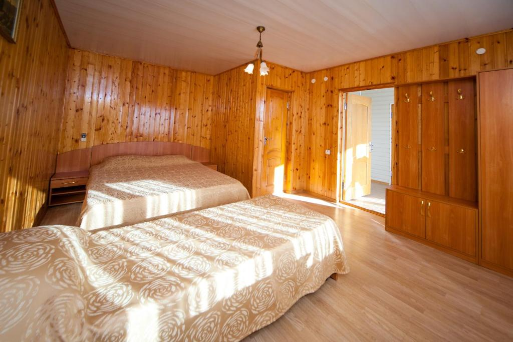 A bed or beds in a room at Lera Guest House