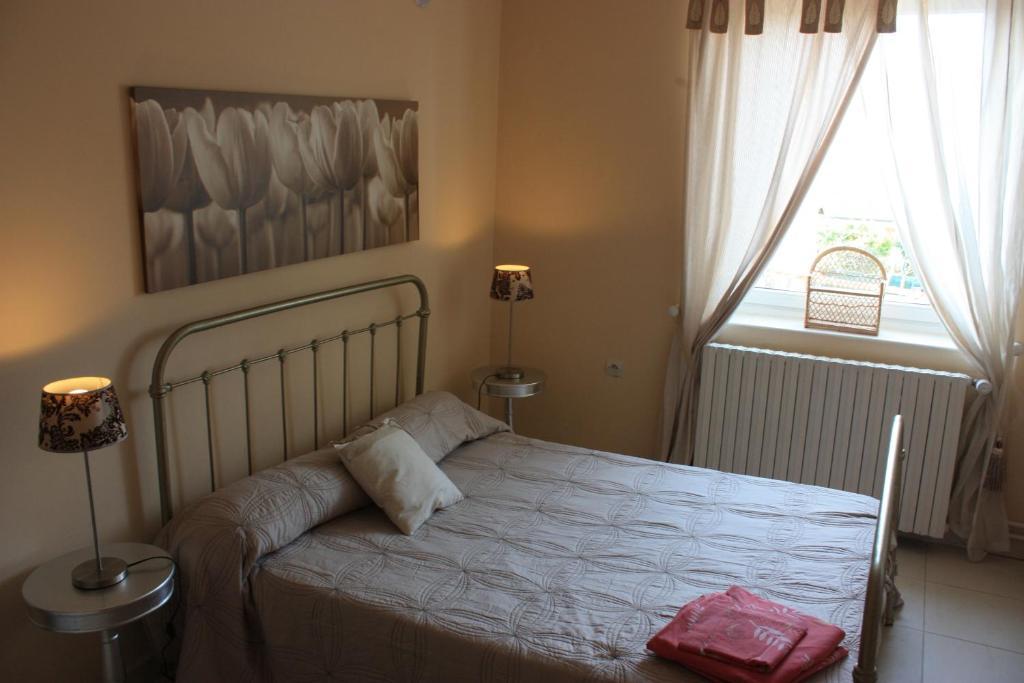Un ou plusieurs lits dans un hébergement de l'établissement Gîte le St Vincent