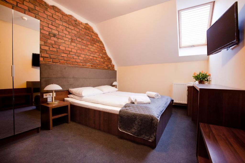 Posteľ alebo postele v izbe v ubytovaní Aparthotel W Pałacu