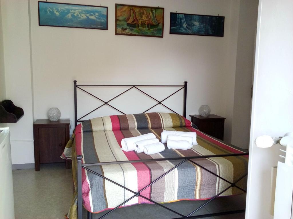 A bed or beds in a room at B&B La Cubanina