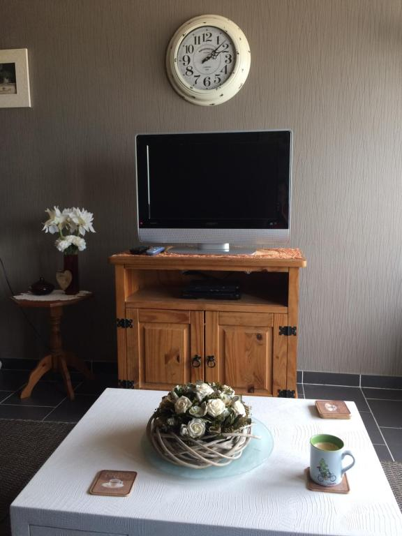 Een TV en/of entertainmentcenter bij Residentie Maria Lucia
