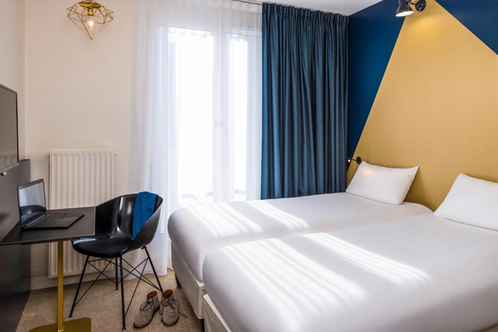 イビス スタイルズ パリ 15 ルクルブにあるベッド