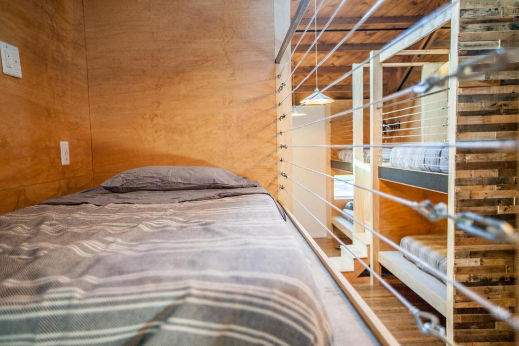 A bed or beds in a room at PodShare Venice