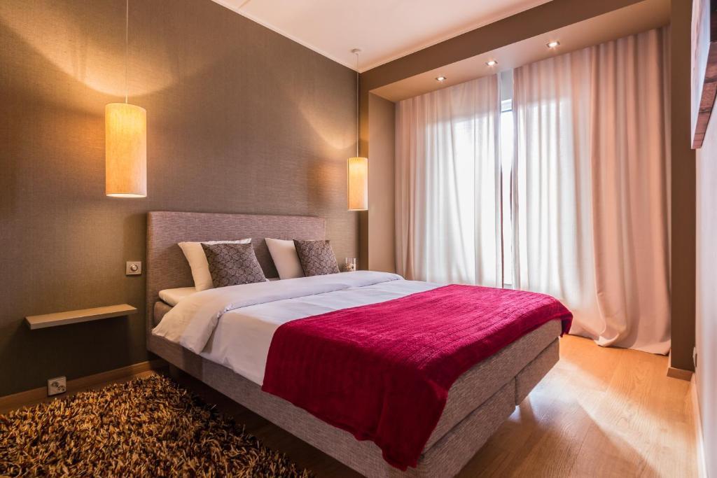 Voodi või voodid majutusasutuse Hilltop Apartments - City Centre Foorum toas