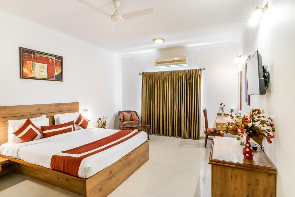 A bed or beds in a room at Octave Hotel - Double Road