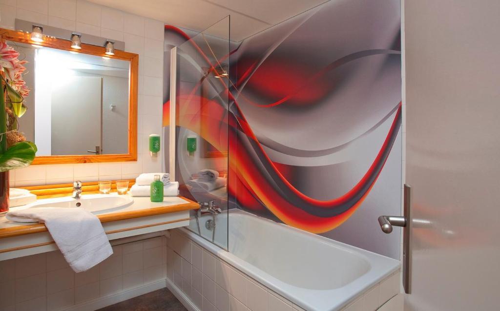Salle de bains dans l'établissement Hotel du Golf Le Lodge