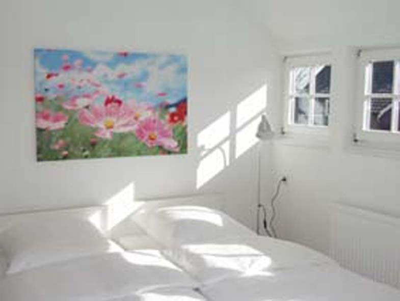 Ein Bett oder Betten in einem Zimmer der Unterkunft Haus 10 Zimmer