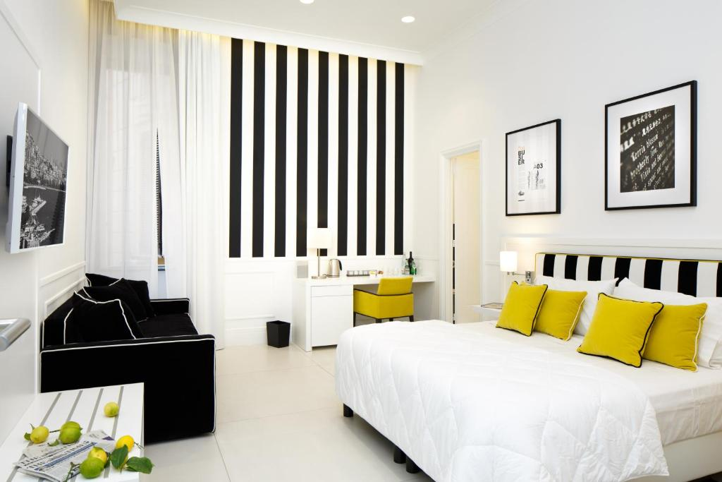 A bed or beds in a room at Nap Luxury Guest House