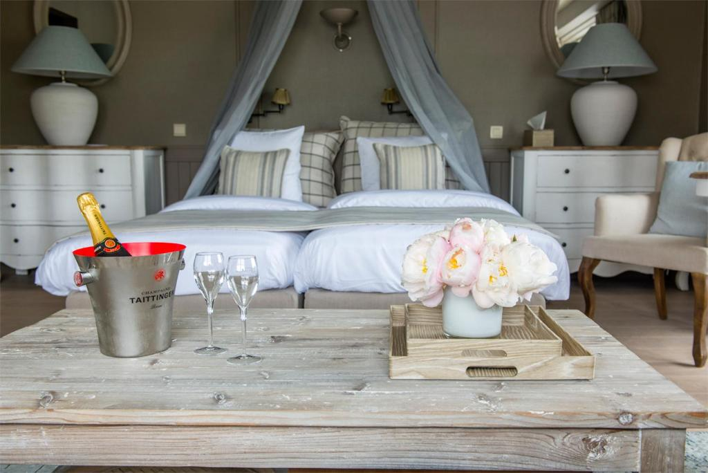 Ein Bett oder Betten in einem Zimmer der Unterkunft Lebeau Hotel