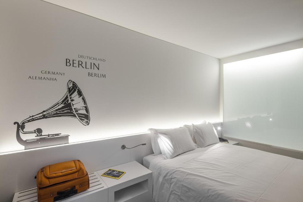 Uma cama ou camas num quarto em Hotel 3K Europa