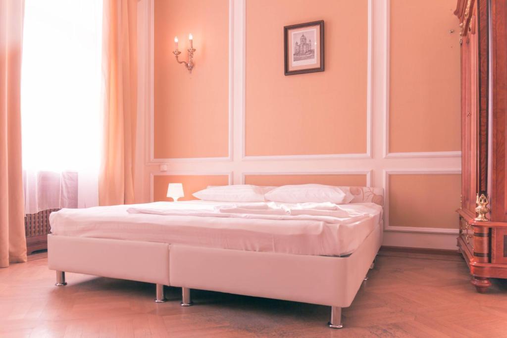 Кровать или кровати в номере Арум Отель на Китай-Городе