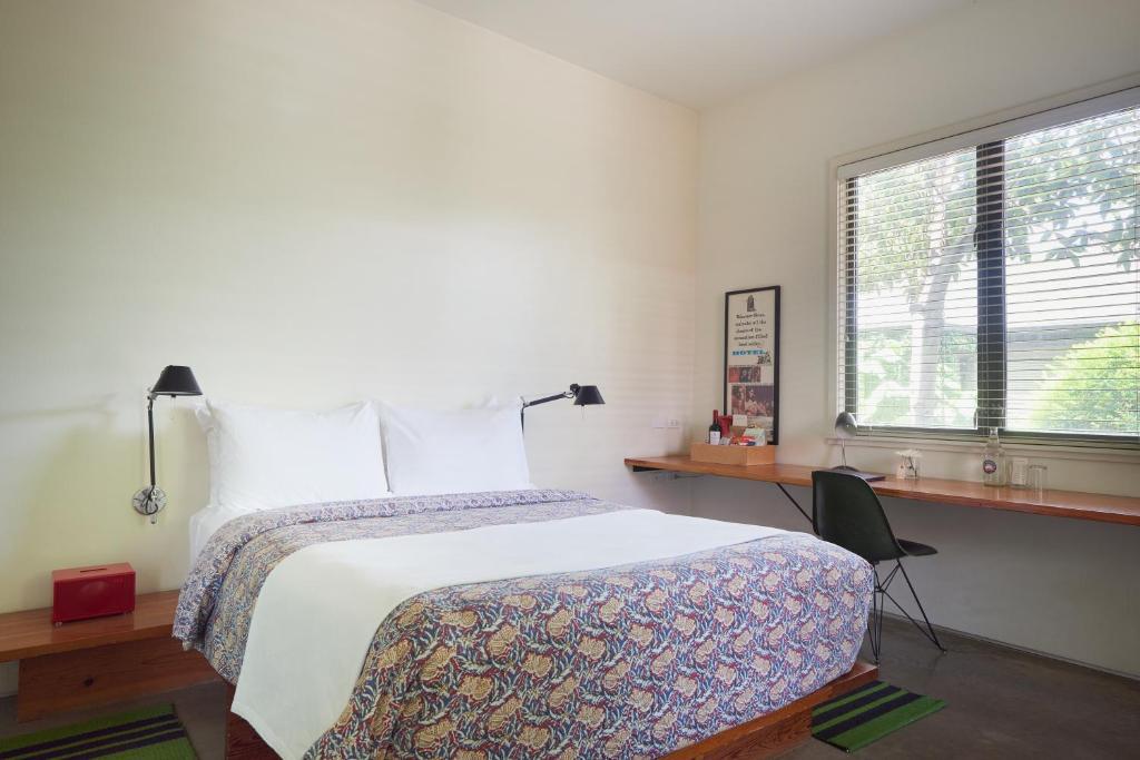 Een bed of bedden in een kamer bij Hotel San Jose