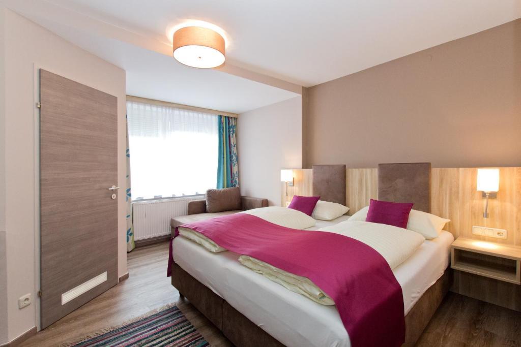 Ein Bett oder Betten in einem Zimmer der Unterkunft Hotel Junior