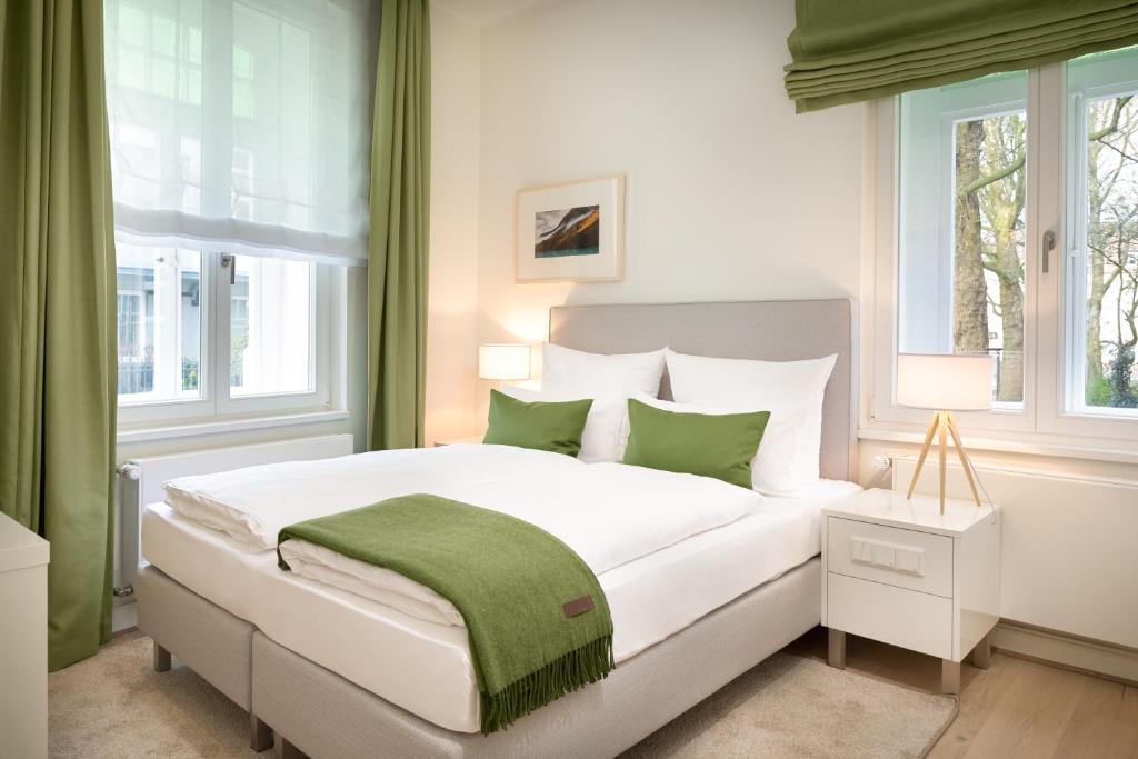 Ein Bett oder Betten in einem Zimmer der Unterkunft Bergmann Boardinghouse Osnabrück