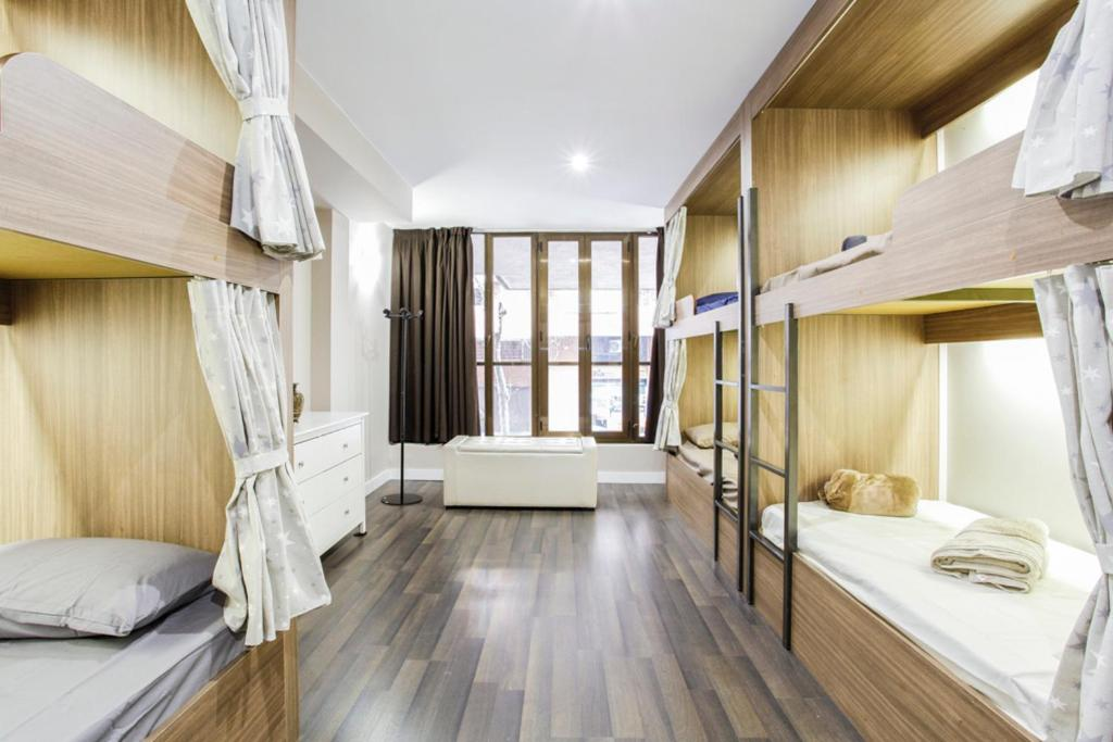 A bunk bed or bunk beds in a room at Barcelona & You Hostel Sagrada Familia