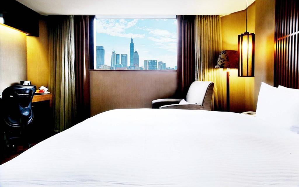 เตียงในห้องที่ LeaLea Garden Hotels - Taipei