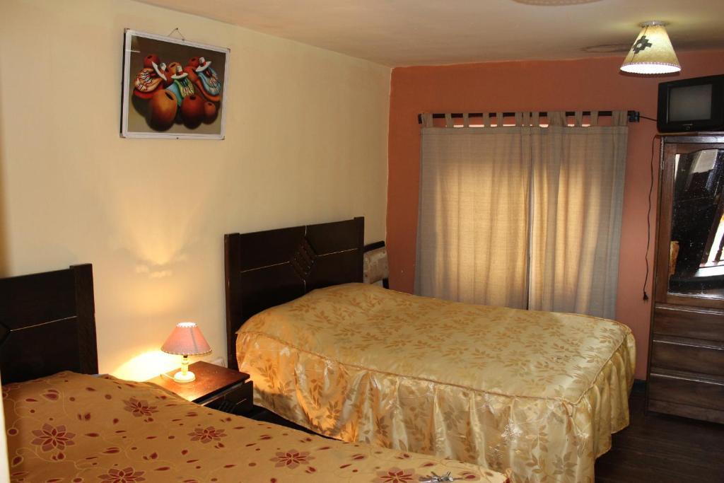 Cama o camas de una habitación en Robertos Hostel