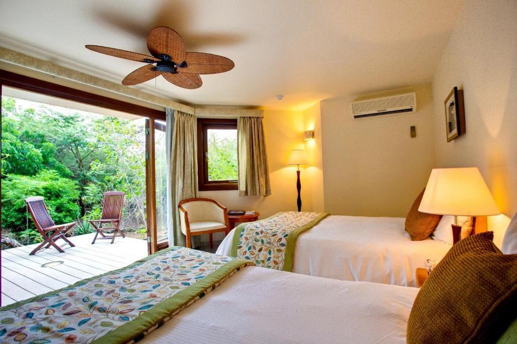 Cama o camas de una habitación en Kura Hulanda Lodge & Beach Club - All Inclusive