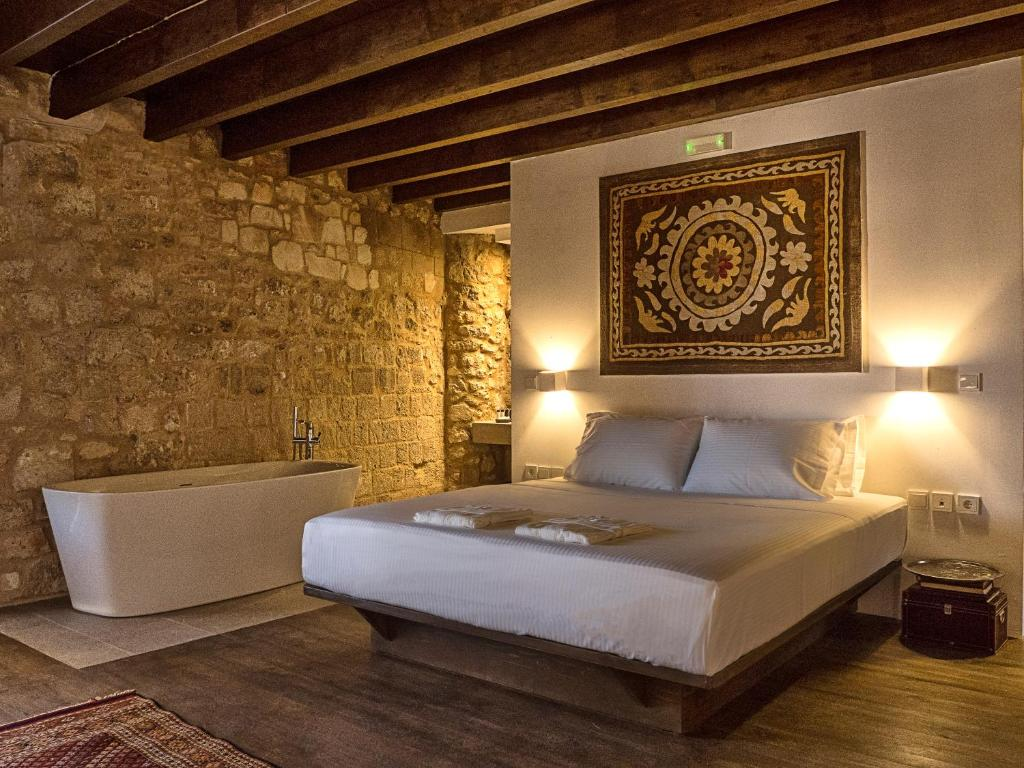 A bed or beds in a room at Trinity Boutique Hotel