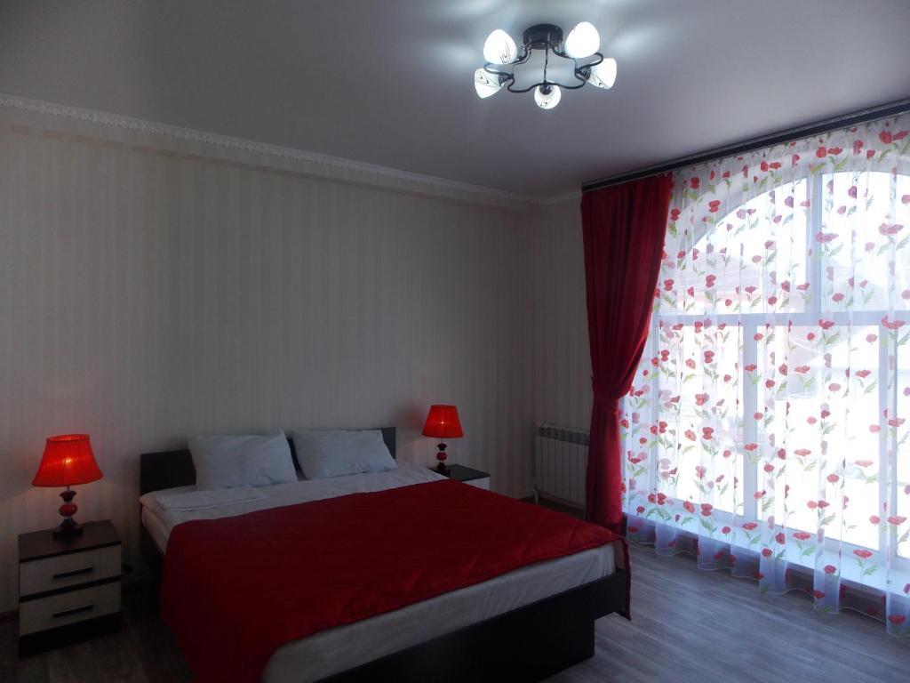 Кровать или кровати в номере Mini-hotel Maki on 9 Maya