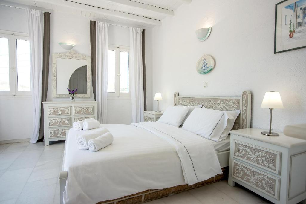 A bed or beds in a room at Margarita's House