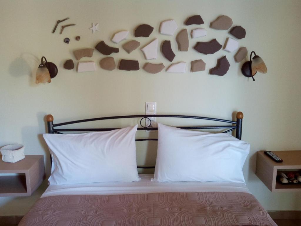 Ένα ή περισσότερα κρεβάτια σε δωμάτιο στο Studios Katerina