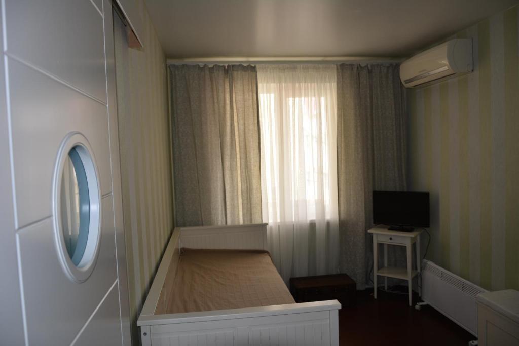 Телевизор и/или развлекательный центр в Guest House Barabulka