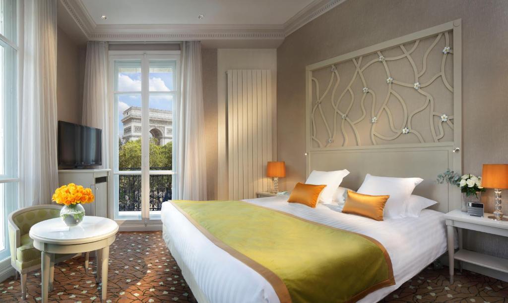 Кровать или кровати в номере Splendid Etoile