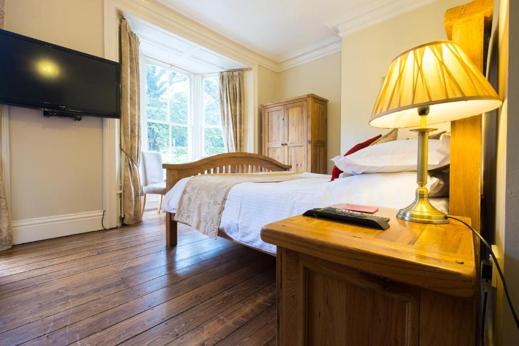 A bed or beds in a room at Broomfield House
