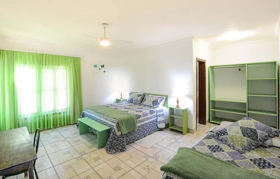 Cama ou camas em um quarto em Pousada Recanto Indaia