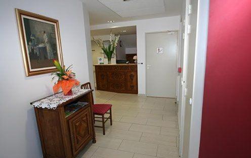 A kitchen or kitchenette at Hotel Lafon