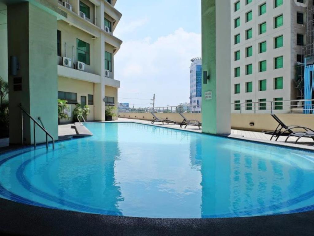 The swimming pool at or near Mandarin Plaza Hotel