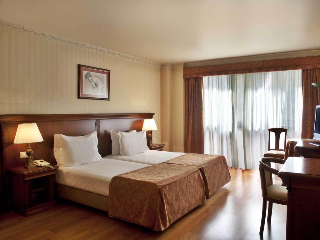 Cama o camas de una habitación en TURIM Lisboa Hotel