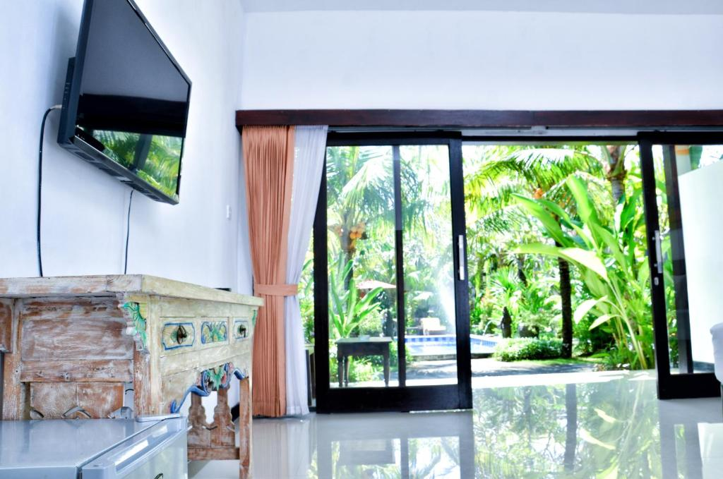 A television and/or entertainment center at Palm Garden Bali
