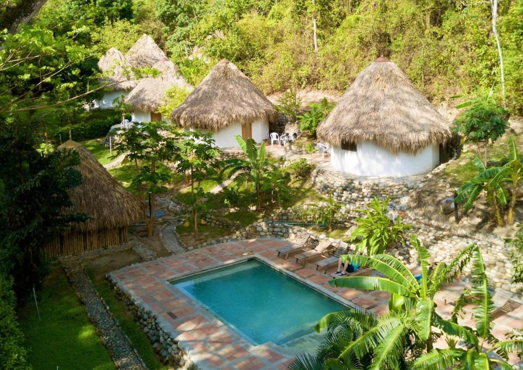 A view of the pool at Finca Carpe Diem or nearby