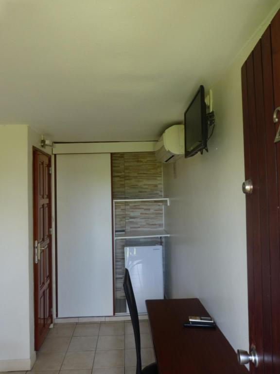 A kitchen or kitchenette at Airport hotel