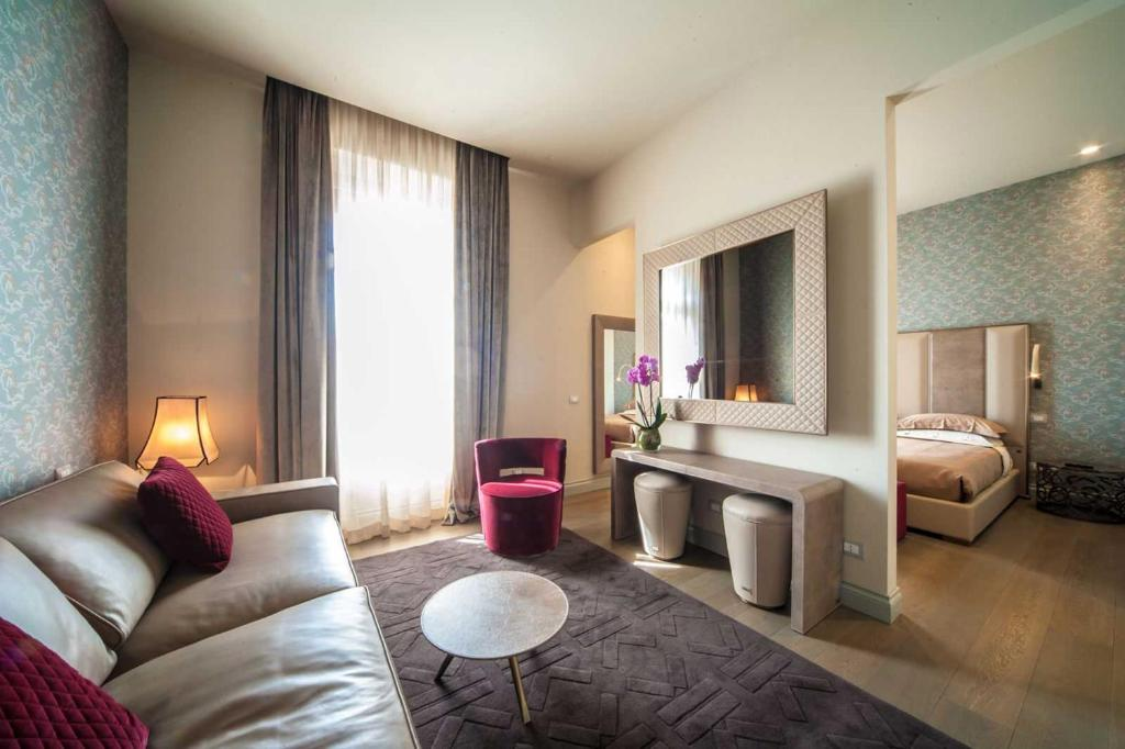 A seating area at Vittoriano Luxury Suites