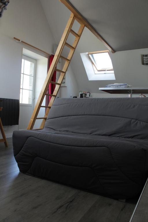 Un ou plusieurs lits dans un hébergement de l'établissement Studio À Lonrai