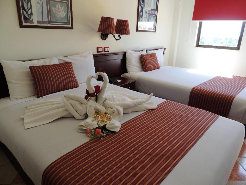 Un ou plusieurs lits dans un hébergement de l'établissement Hotel Residencial