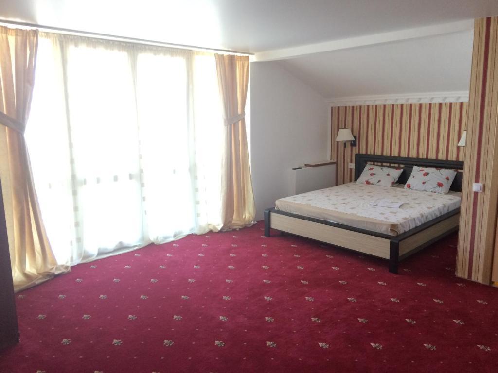 Ένα ή περισσότερα κρεβάτια σε δωμάτιο στο Guest house on Oktyabrskaya