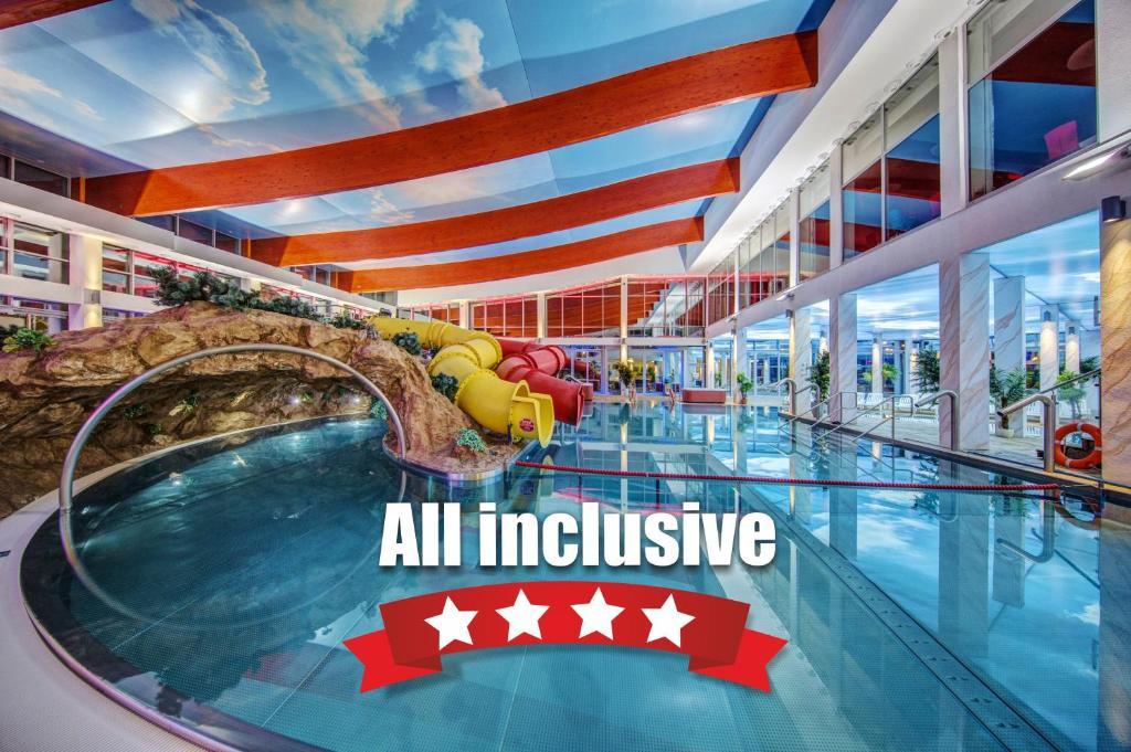 The swimming pool at or near Aquapark Health Resort & Medical SPA Panorama Morska All Inclusive