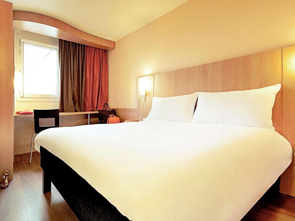 Un ou plusieurs lits dans un hébergement de l'établissement ibis Rambouillet