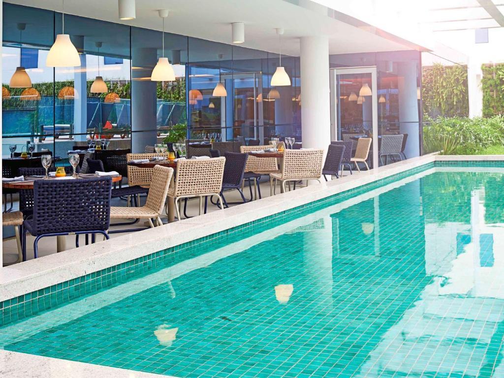 The swimming pool at or near Novotel Rio de Janeiro Parque Olimpico