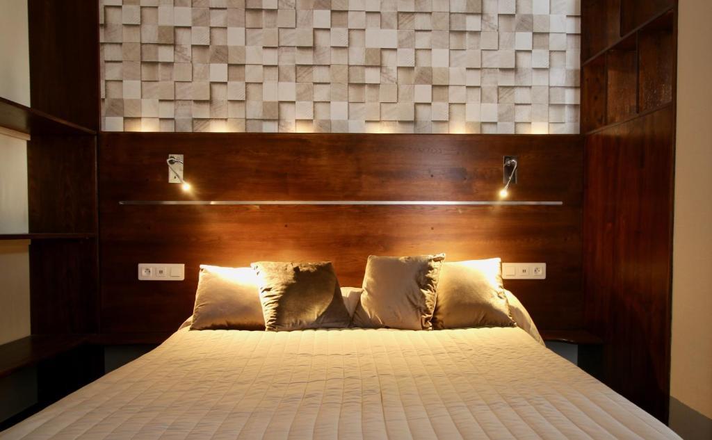 Lova arba lovos apgyvendinimo įstaigoje Hotel des Pyrénées