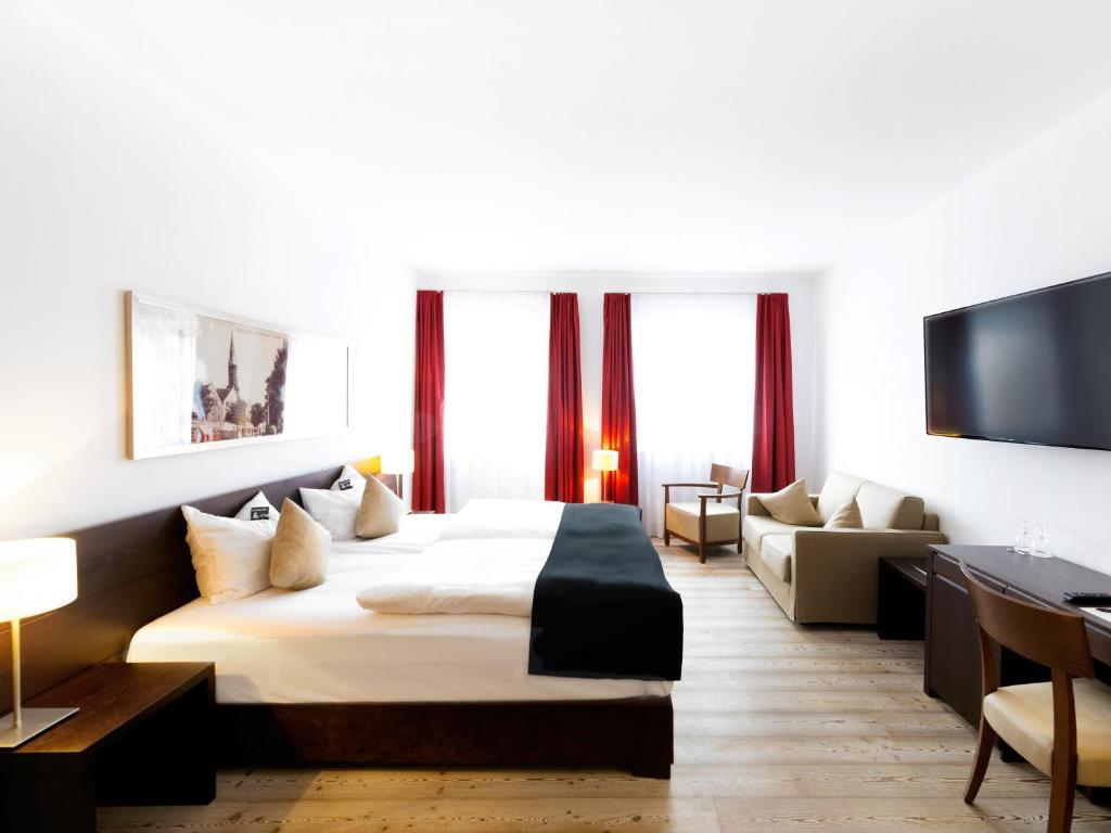 A bed or beds in a room at DORMERO Hotel Kelheim